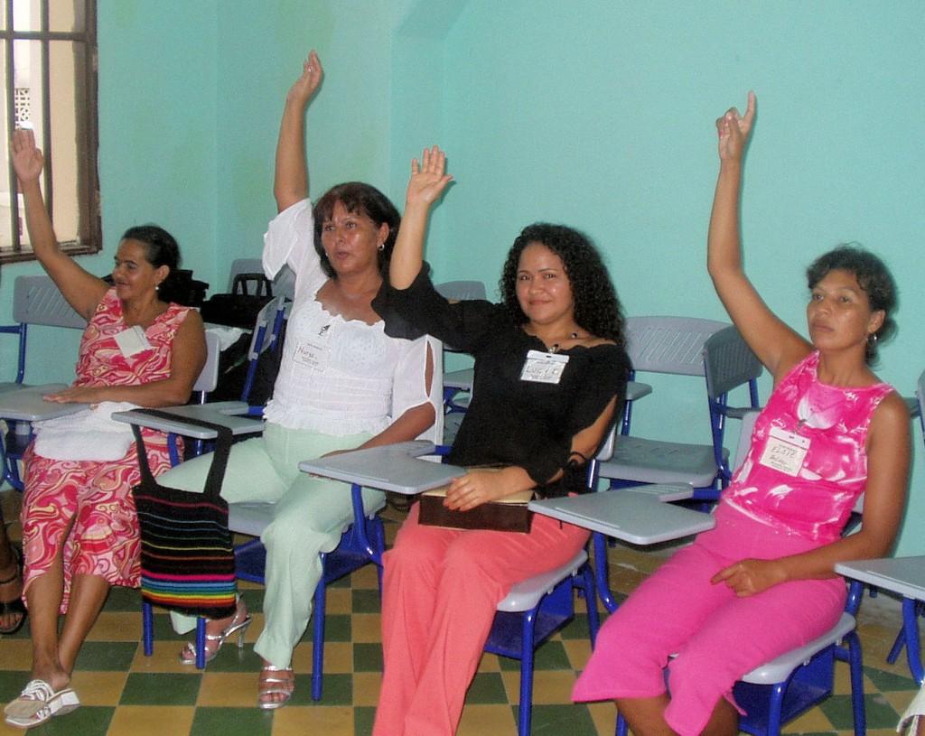 Colombian 4 women-raising-hands